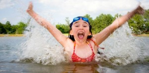 girl-swims-triumphantly-in-lake-612x300